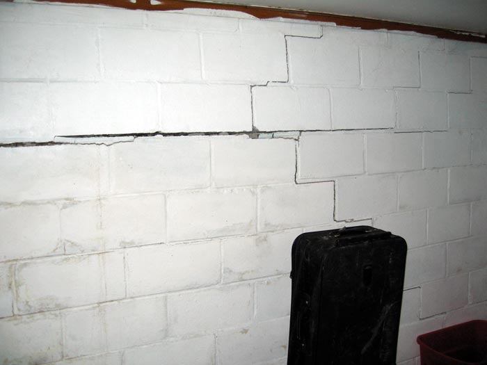 what causes basement wall failure