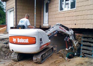 a contractor removing and rebuilding a foundation