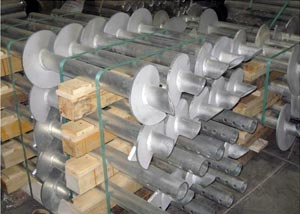 galvanized steel helical piers awaiting installation in a warehouse